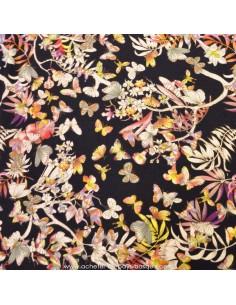 Jersey viscose fond noir motifs feuillage et papillons - Tissus Habillement Docks Negresse Biarritz en vente
