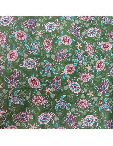 Coton motifs style tahitien tortues et coquillage sur fond vert - Tissus Ameublement habillement - Tissus des Docks  Biarritz