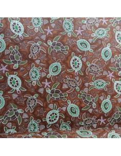 Coton motifs style tahitien tortues et coquillage sur fond marron - Tissus Ameublement habillement - Tissus des Docks  Biarritz